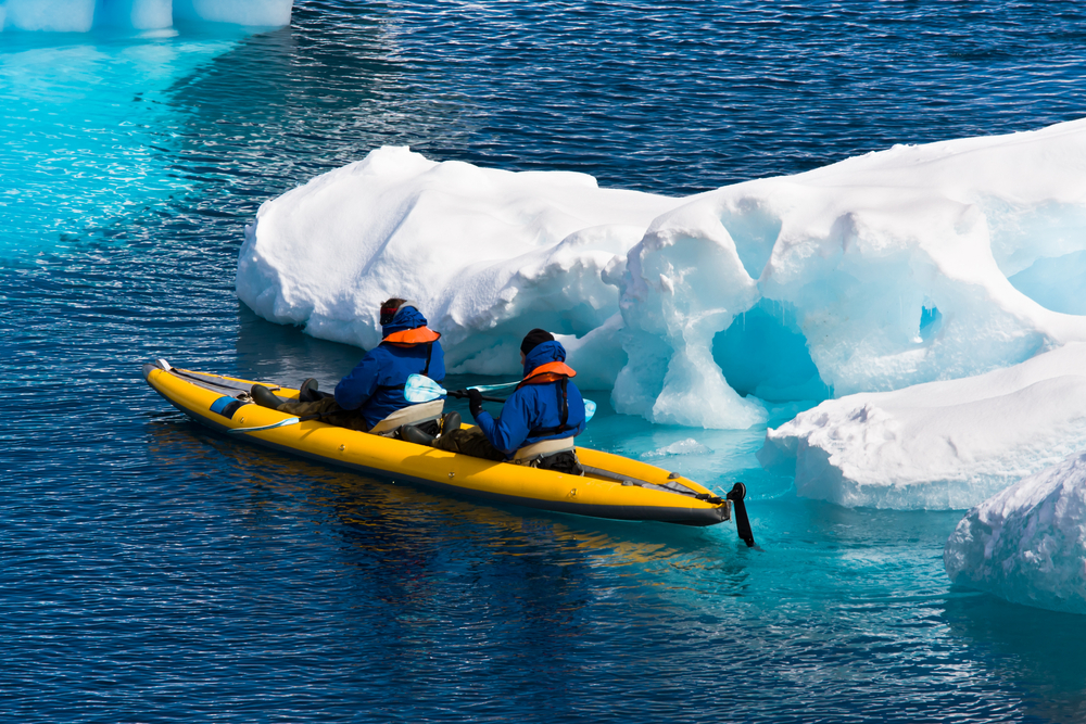 Kayaking  between floating ice shelves.