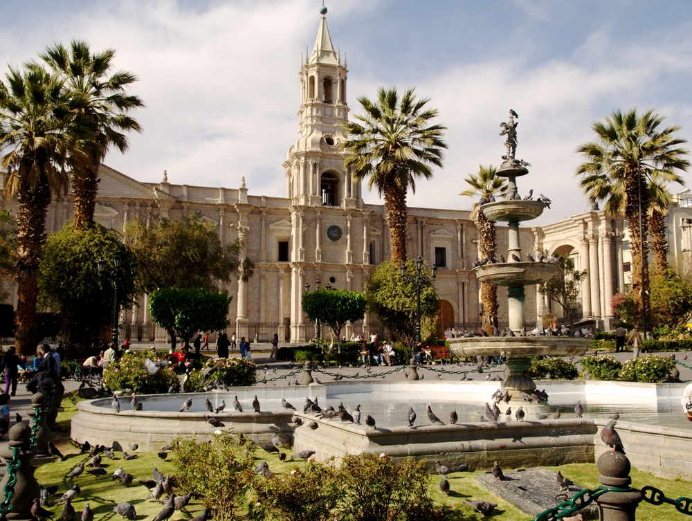 plaza in peru with spanish colonial architecture