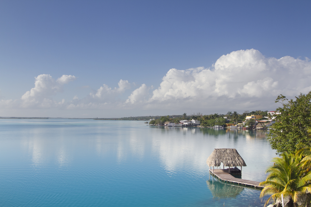 blue sea with floating hut and green coastline Bacalar Mexico