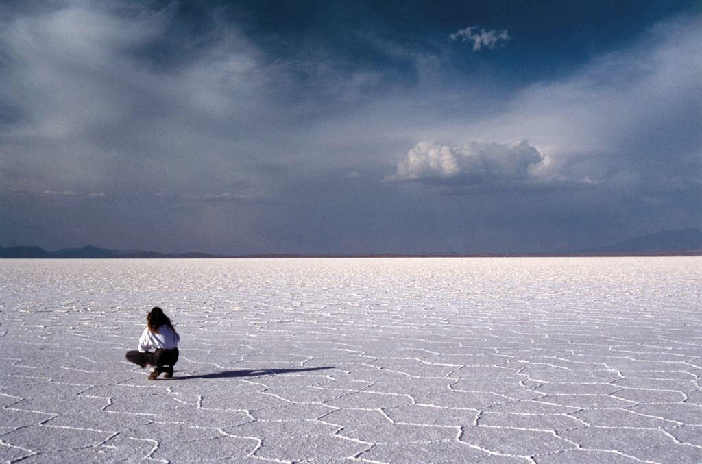 salt flats bolovia with person sitting