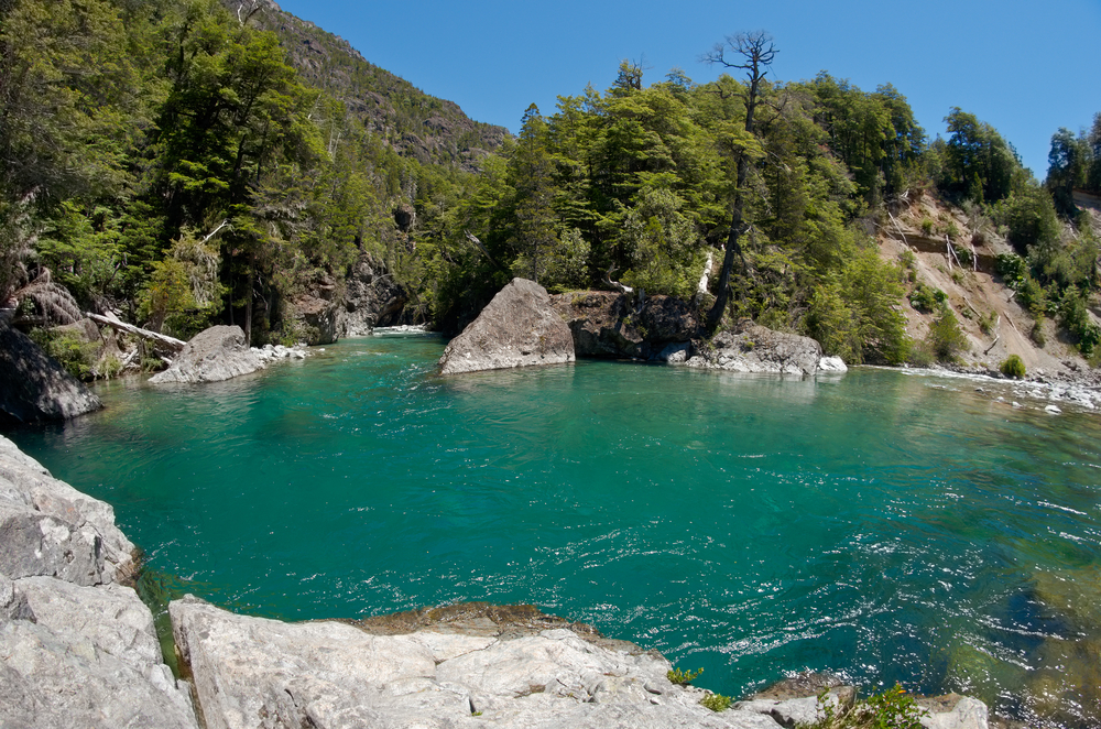 blue lake surrounded by forest El Bolson Argentina