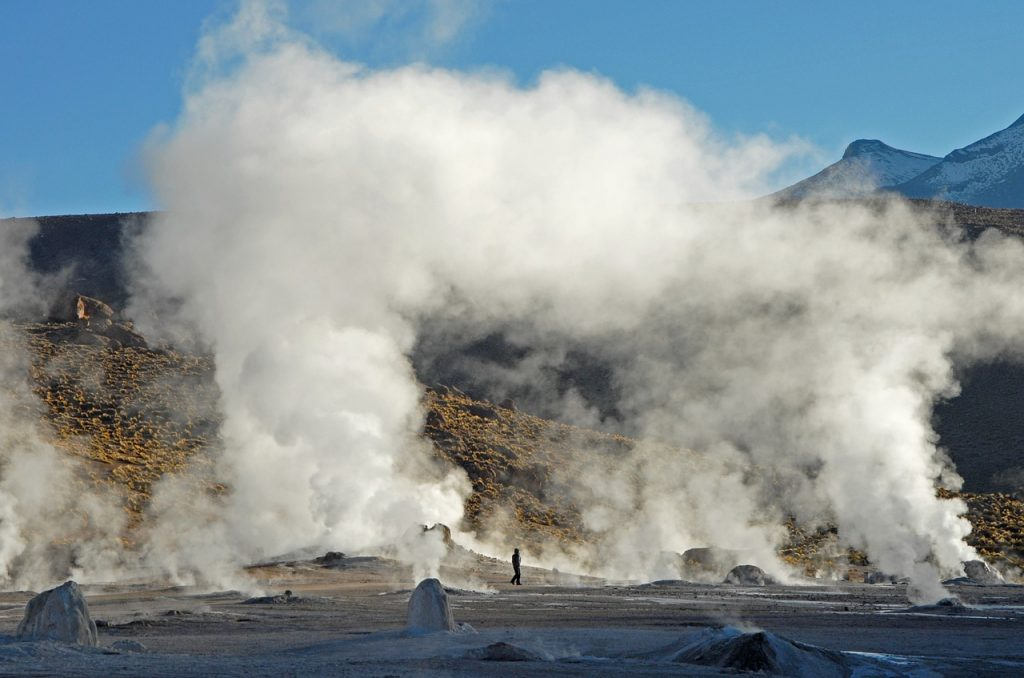 Geysers with smoke in front of a mountain chile