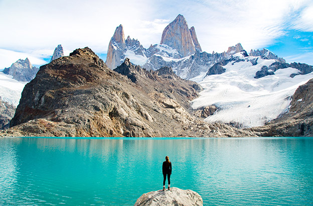 A hiker enjoys the view of Mt Fitzroy in Patagonia