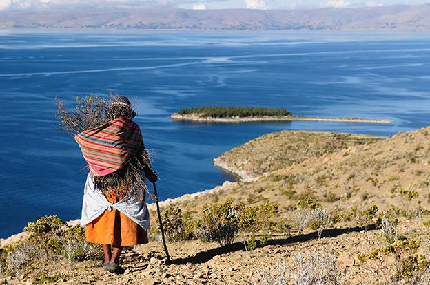 A local person looks over Lake Titicaca, Peru