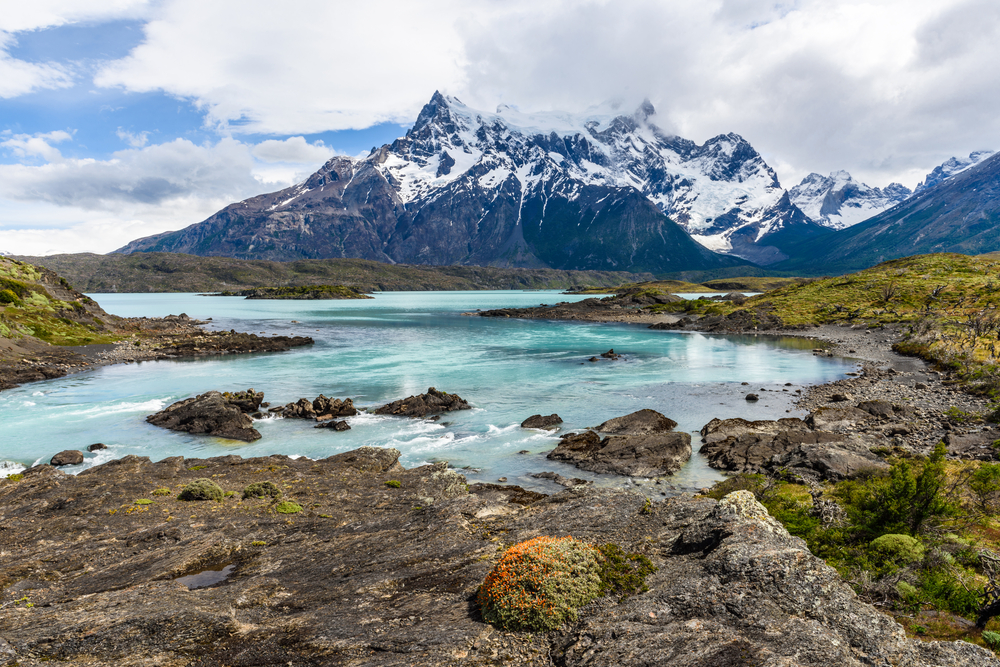 Patagonia, blue lake with snow capped mountains in the background