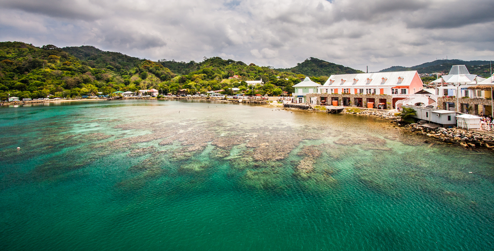coastal town of roatan next to blue sea in honduras
