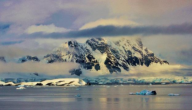 Snow capped mountains, Antarctica.