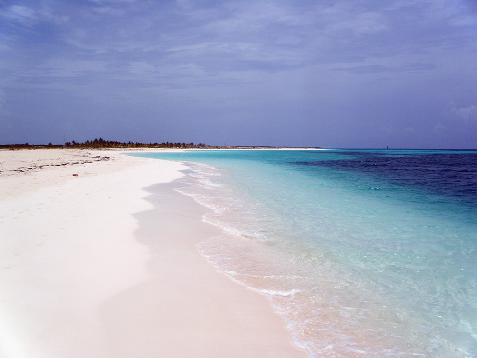 latin-america ; white sandy beach and blue waters cuba