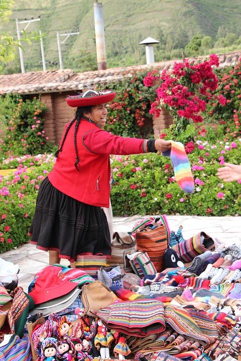 local woman selling crafts in Peru