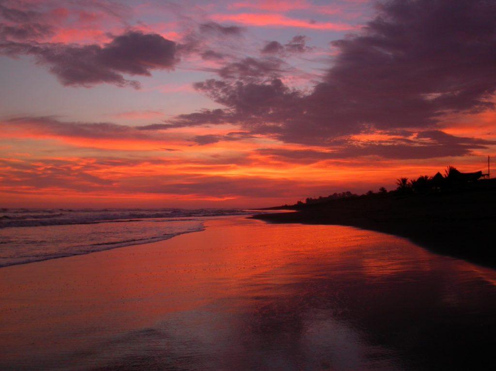 orange sunset over beach El Paredon