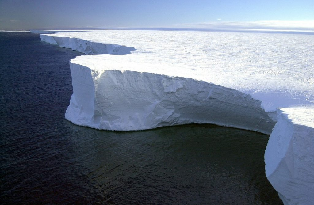 ice shelf next to a dark sea.