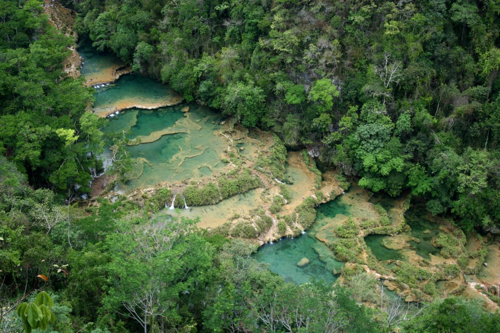blue river in forest in guatemala