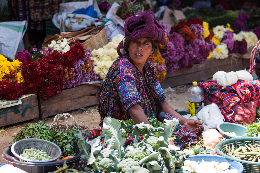 guatamala lady sitting in fruit market