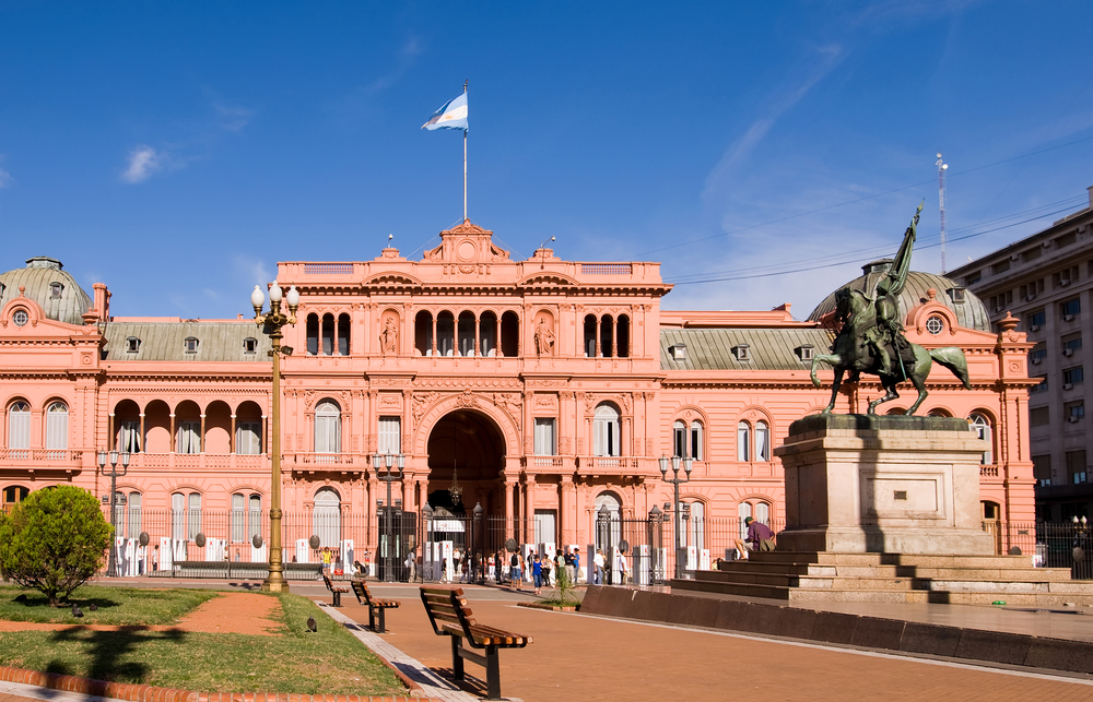 pink building on a square in buenos aires