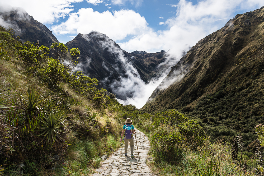 hiker on the inca trail hiking between the mountains peru