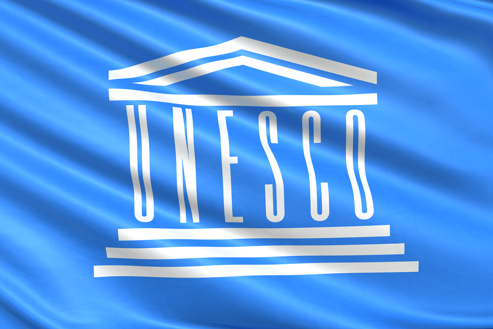 UNESCO logo on blue flag