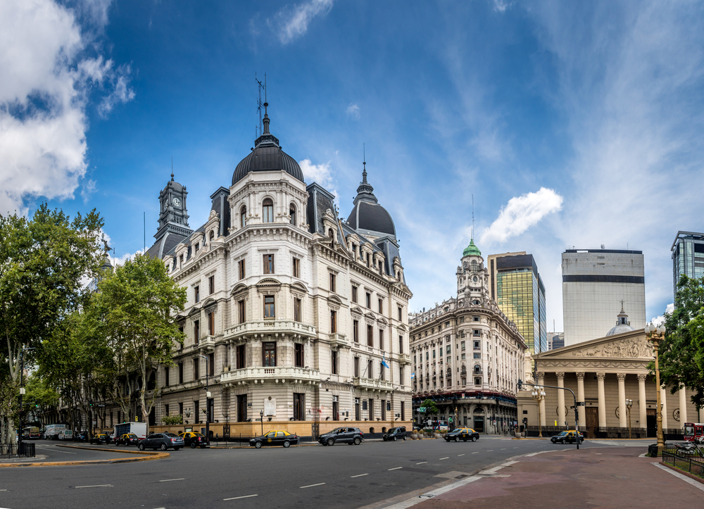 colonial architecture building on the corner with blue sky buenos aires