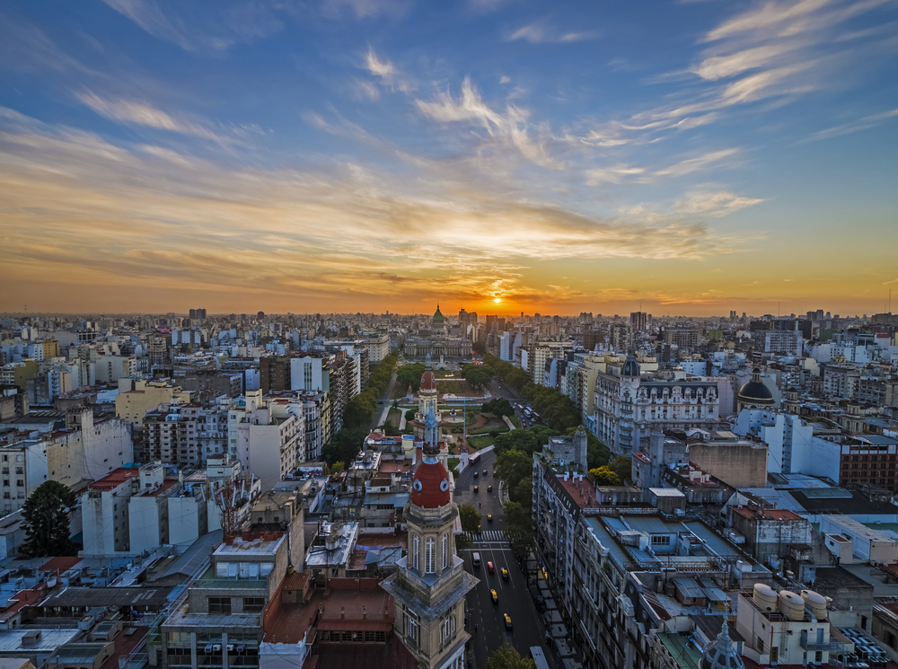 aerial view over the city of buenos aires with sunset