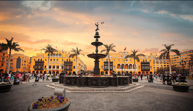 Panoramic of main square in Lima, water fountain and cathedral