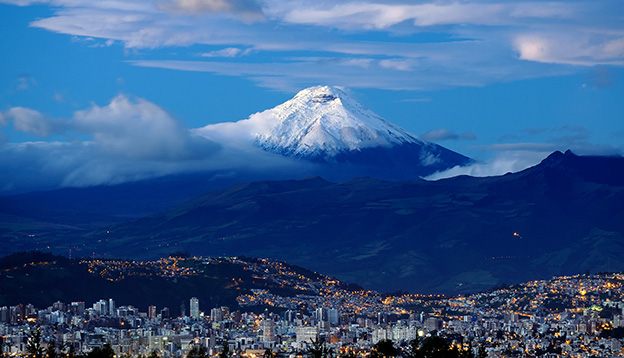 Sunrise in Quito city with Cotopaxi volcano in the background