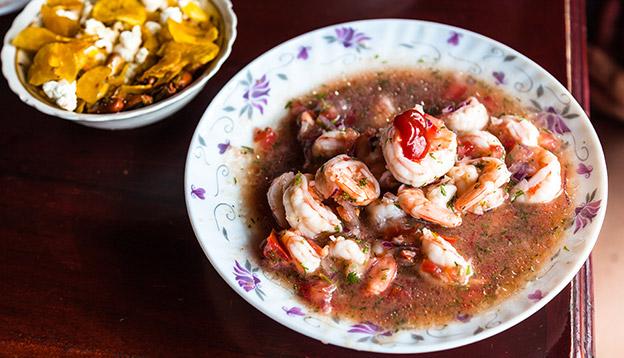 Shrimp ceviche, Ecuadorian traditional dish prepared with orange juice lemon and tomato