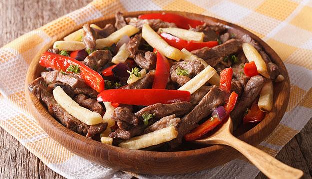 Homemade Peruvian Food: Lomo saltado close-up on a plate. Horizontal