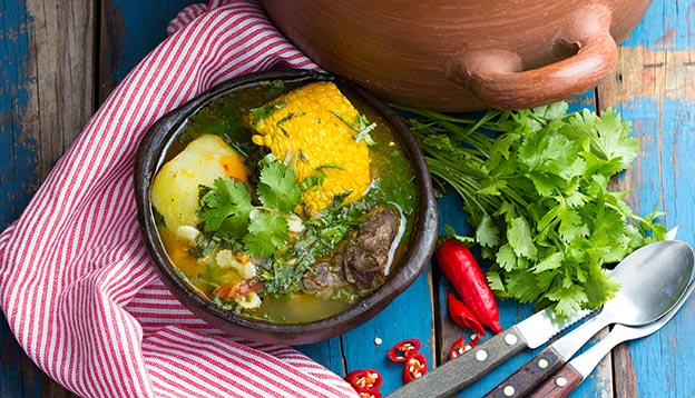 Cazuela - traditional latinamerican soup served in clay plate