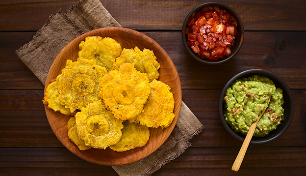 Patacones - fried and flattened pieces of green plantain, traditional snack or accompaniment