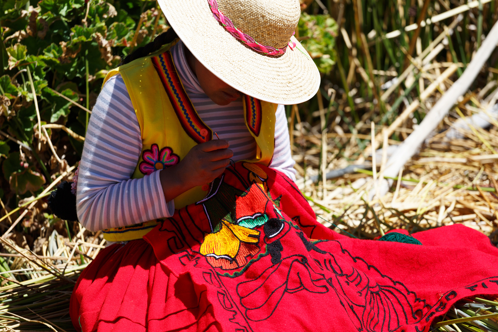 Woman in traditional clothes in Puno, Peru