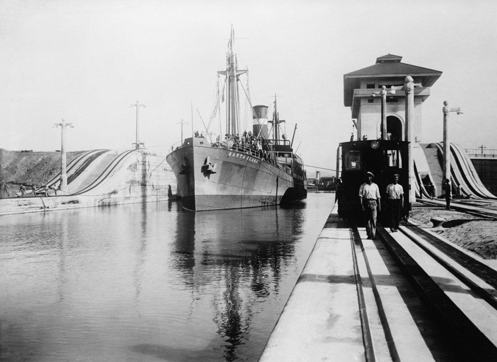 Ships moves through the Miraflores Lock of Panama Canal