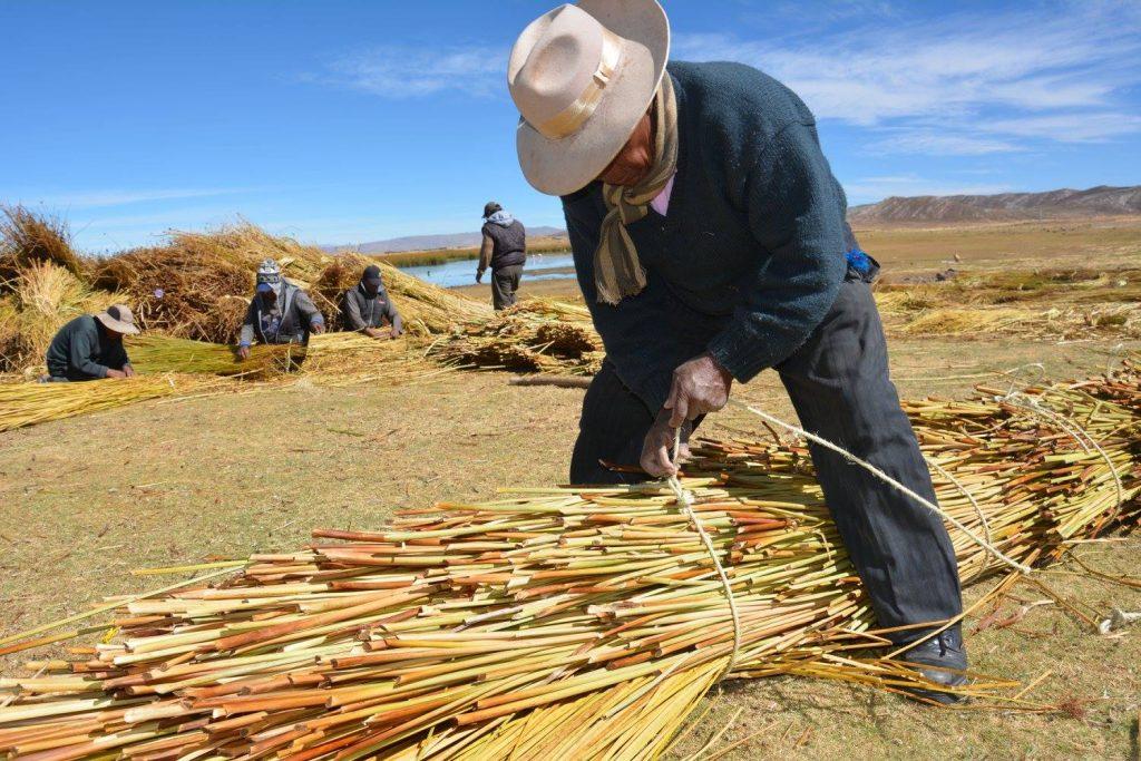Juan Limachi making reed cylinder