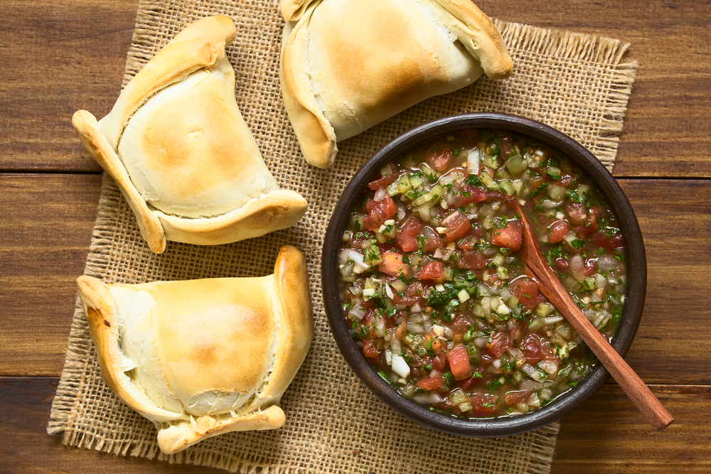 Chilean empanadas with a traditional Chilean Pebre sauc