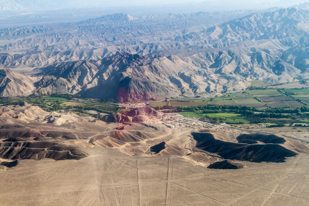 Aerial view of a valley near Nazca, Peru. The famous Nazca Lines are visible as well.