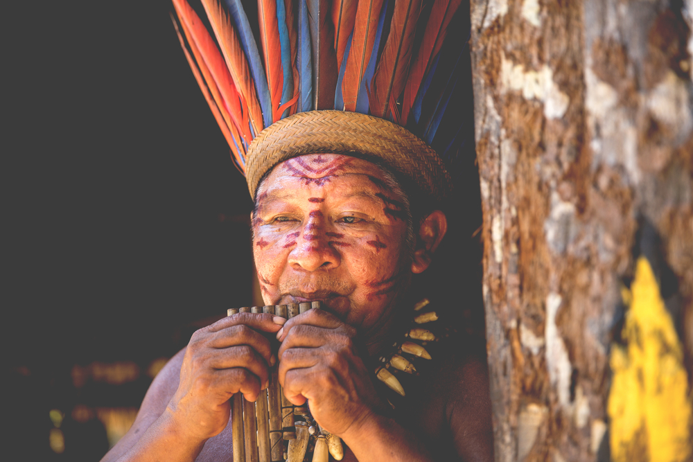 Native Brazilian man at an indigenous tribe in the Amazon.