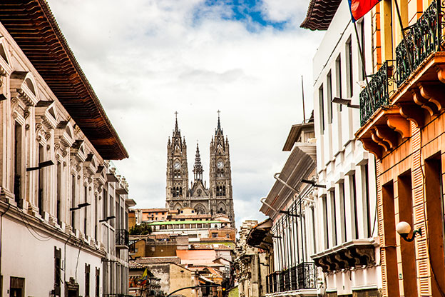 colonial houses overlooking the Cathedral of the National Vow Basilica located in the historic centre of Quito Ecuador