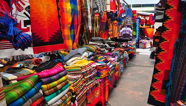 View of stalls in traditional market - Otavalo, Ecuador