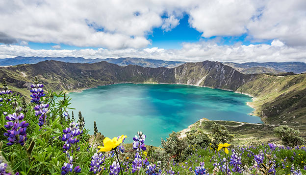 Beautiful panoramic scenery overlooking at Quilotoa lake at the crater rim in Quilotoa, Ecuador