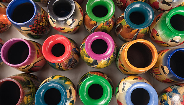 Brightly coloured pottery displayed at an artisan market