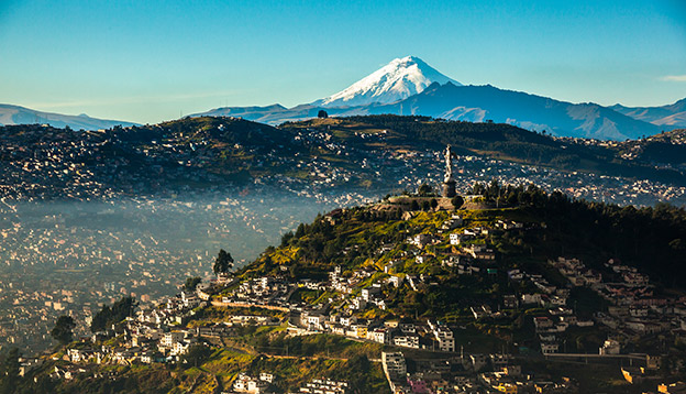The view over Quito with Cotopaxi in the background.
