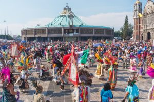 Mexico City, Mexico - December 12, 2016: Celebration of the Day of the Virgin of Guadalupe with a mass ceremony in her honor on square of Basilica of Our Lady of Guadalupe credit shutterstock