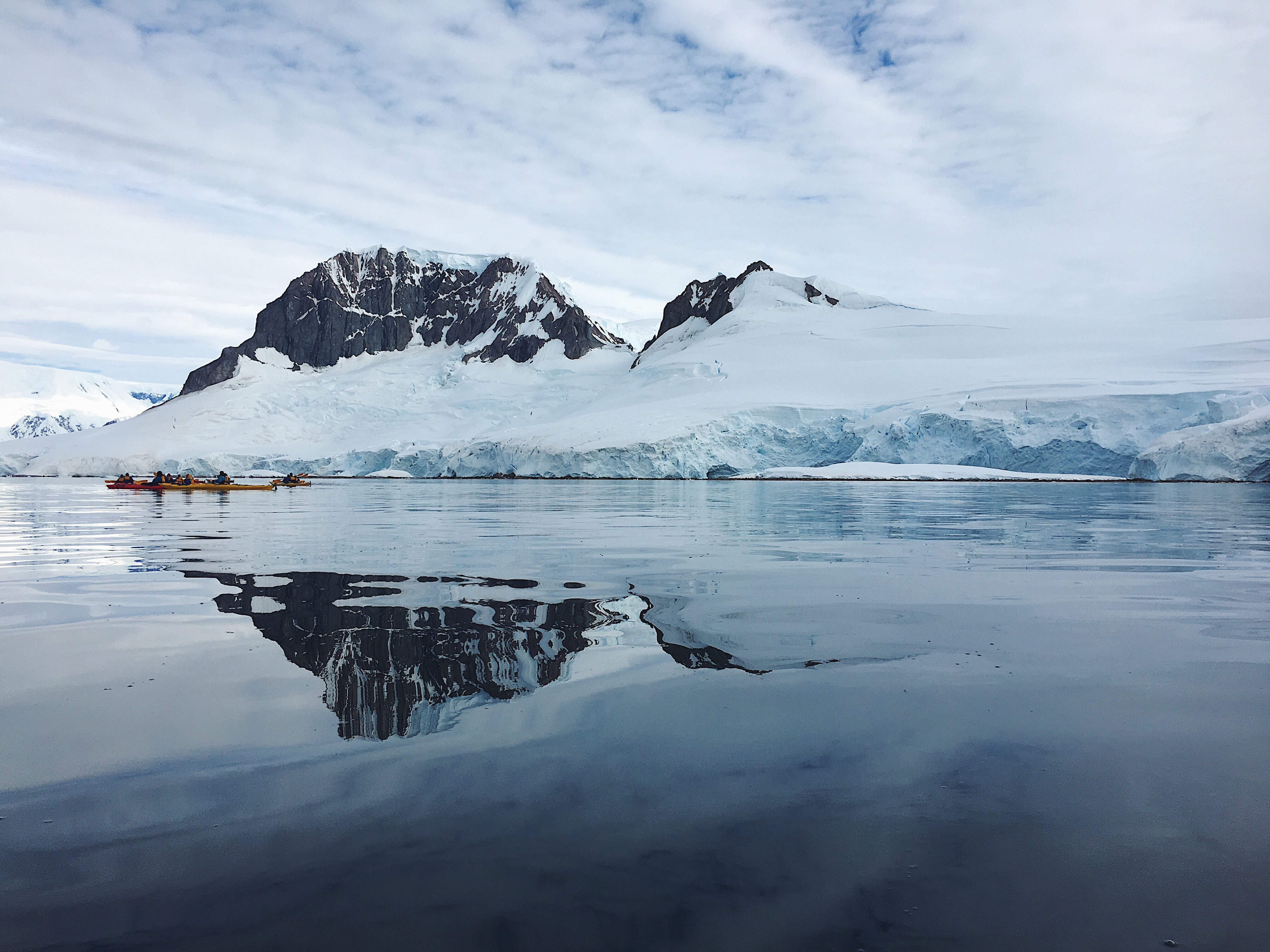 Kayaking on the waters of Antarctica. Experience the fragile landscapes.