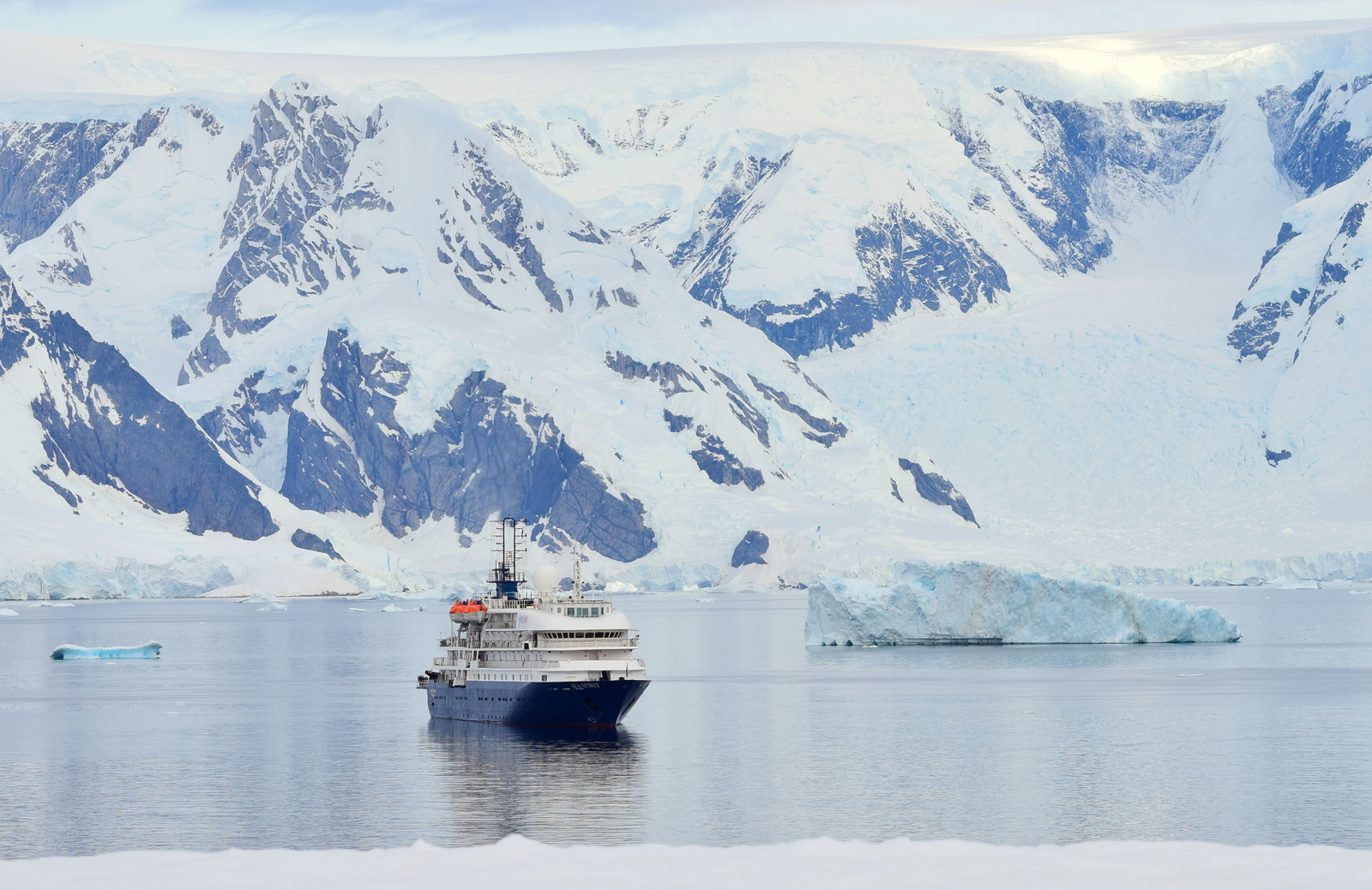 A ship in the background of Hydruga Rocks Antarctica