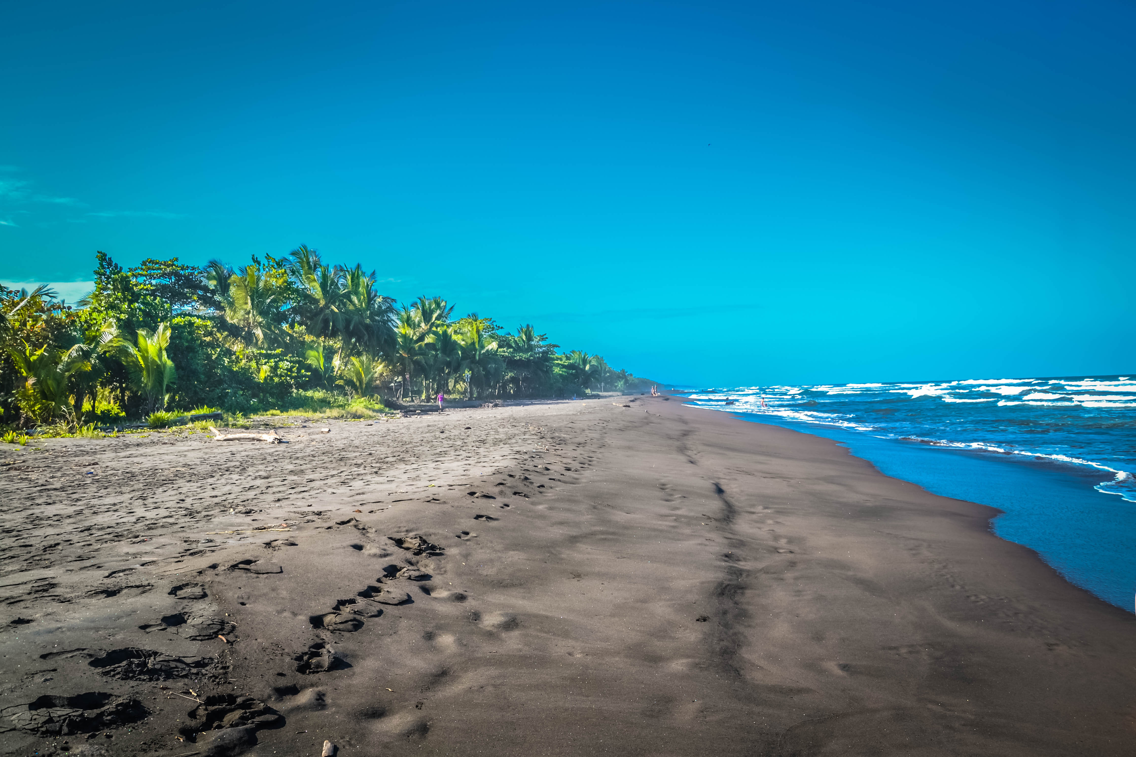 Black sand on the beach in Playa Negra in Costa Rica