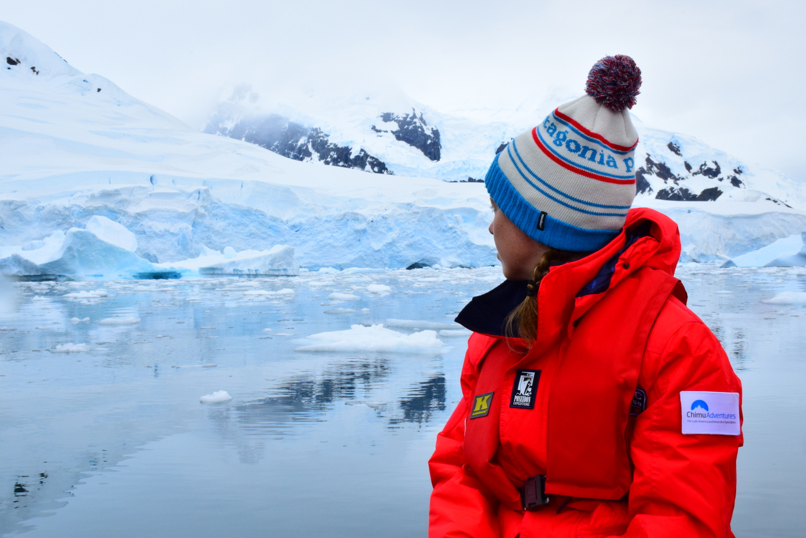Young Antarctica traveler with white snow in the background in Antarctica