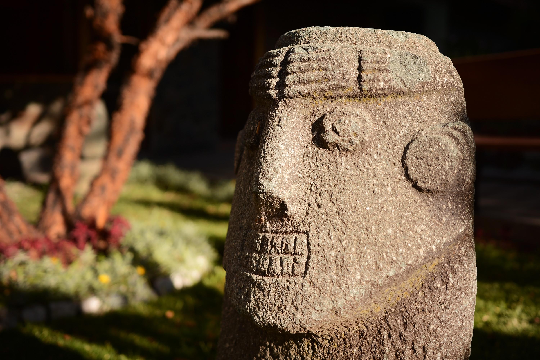 head sculpture outdoors in Cusco Peru
