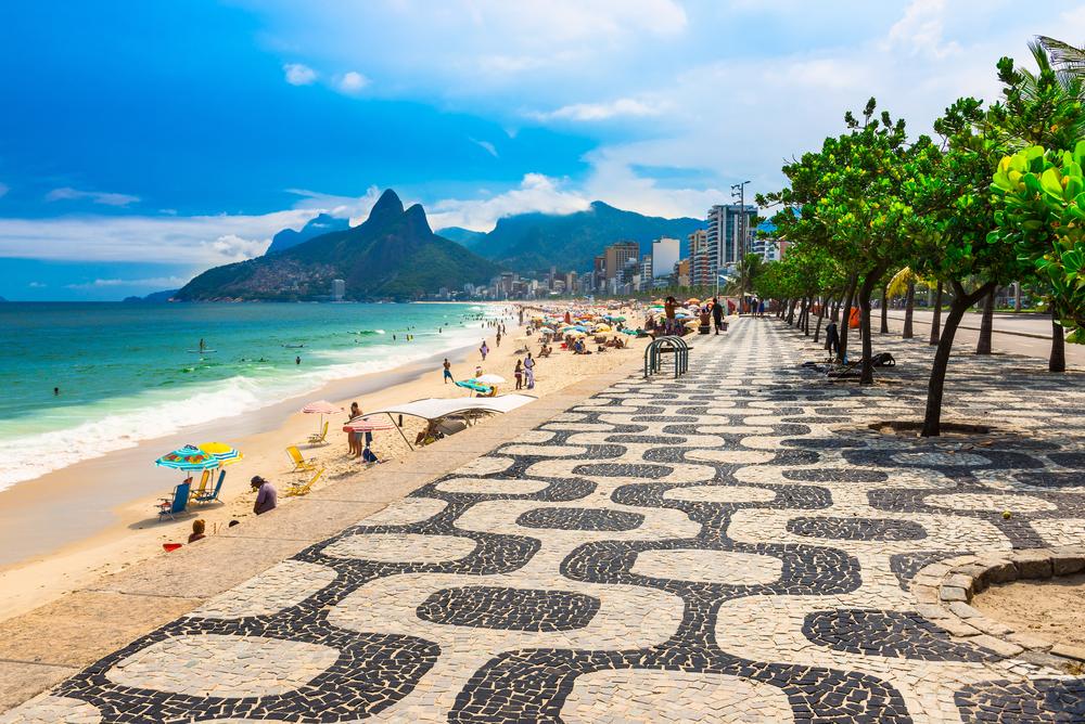 Ipanema beach with mosaic of sidewalk in Rio de Janeiro Brazil