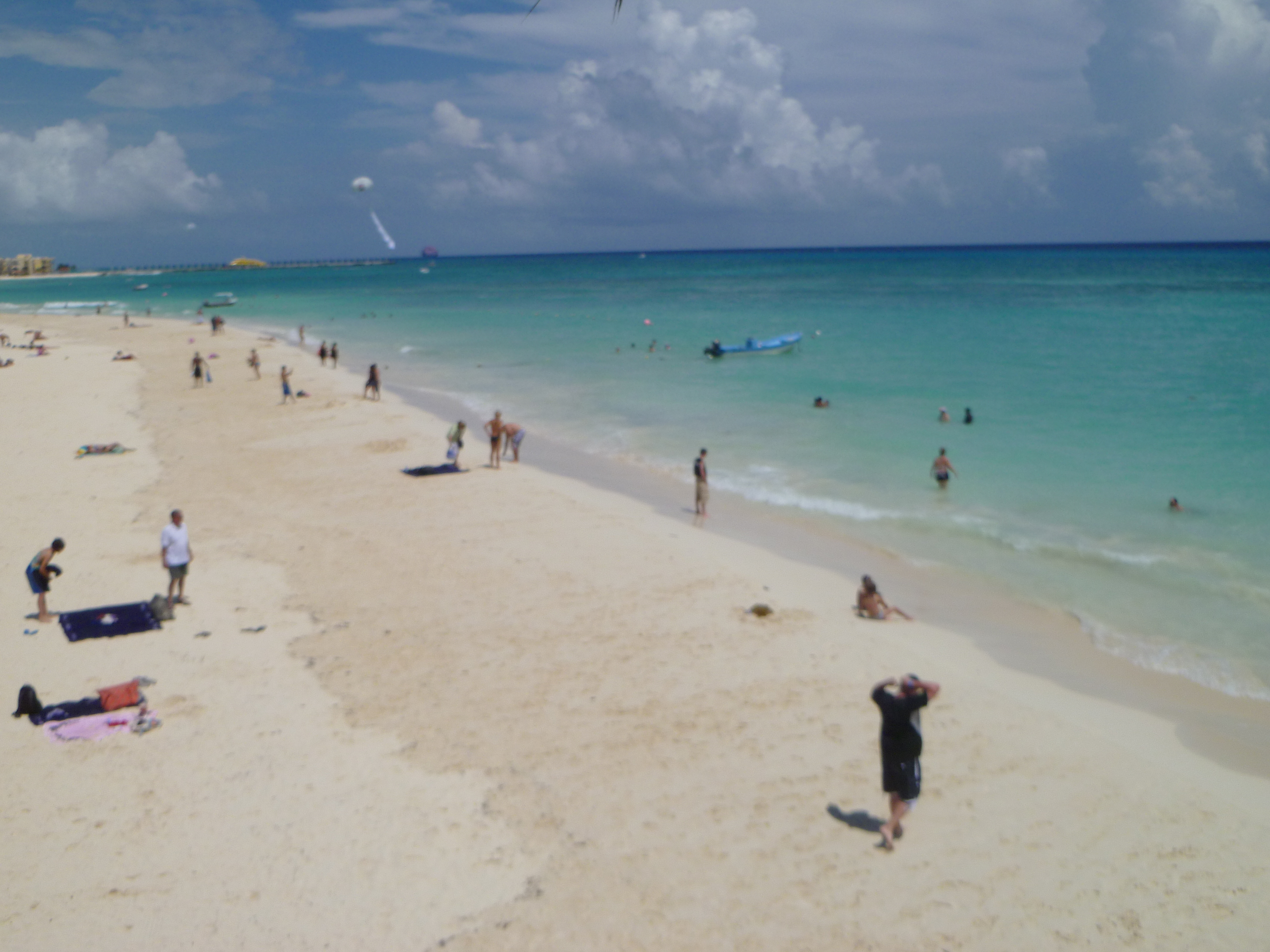 Playa del Carmen in the Riviera Maya in Mexico with people at the beach on a sunny day