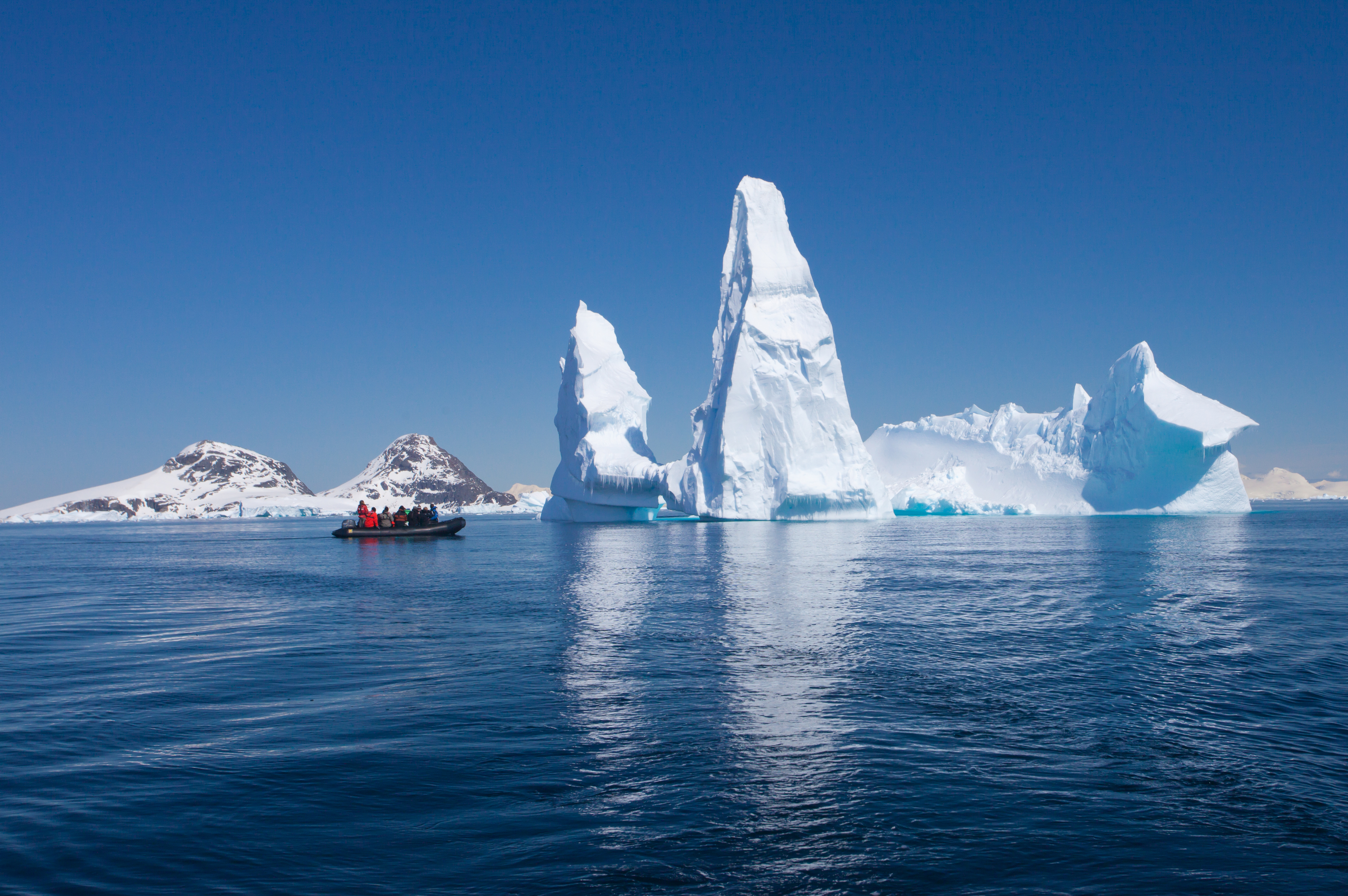 Huge iceberg and reflection in water in Antarctica
