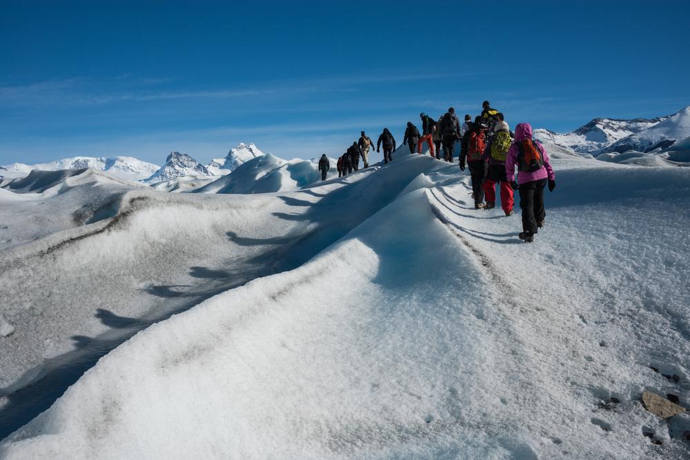 group trekking in at Perito Moreno Glacier, Los Glaciares National Park, Santa Cruz, Argentina