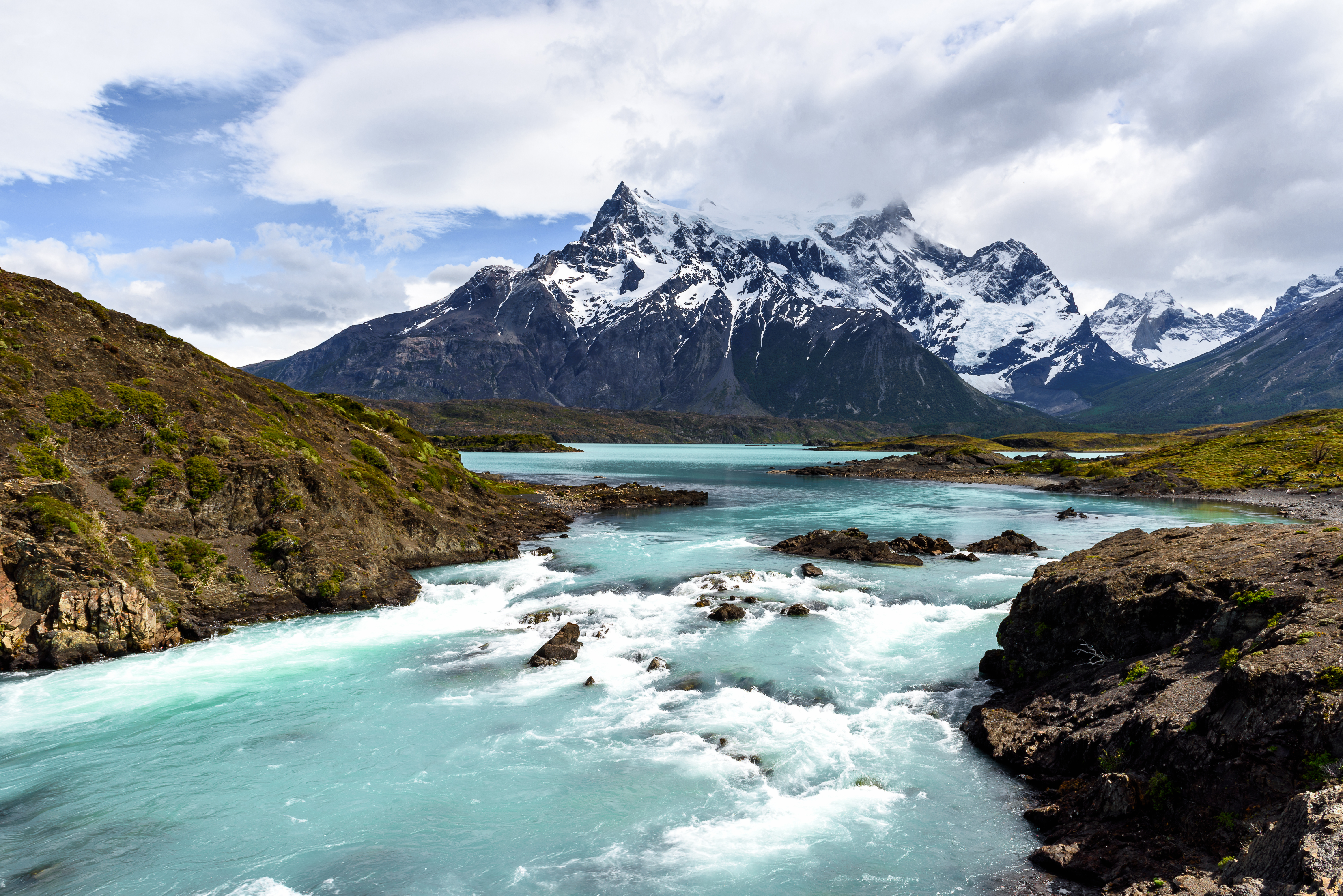 River flowing with mountains in the background at the Torres del Paine national park in Patagonia in Chile